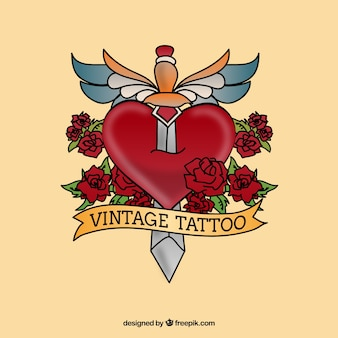 Tatouage vintage avec un poignard sur le cœur