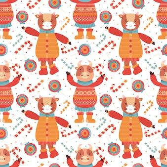 Taureaux de bébé drôle de dessin animé de modèle sans couture avec sucette et canne en bonbon. mascotte de nouvel an 2021. personnage animal de fond en vêtements d'hiver. vache, buffle, veau, bœuf. joyeux noel et bonne année