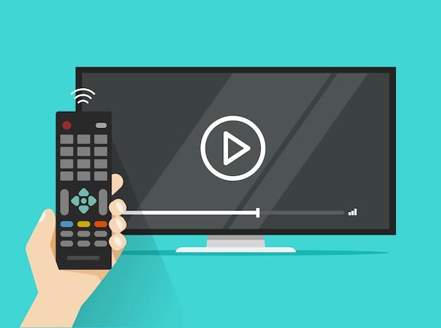 Télécommande dans la main près de l'écran plat led tv regarder un film de dessin animé plat film
