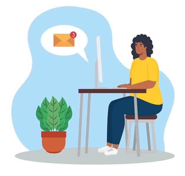 Télétravail, femme afro avec ordinateur au bureau, travaillant à domicile.
