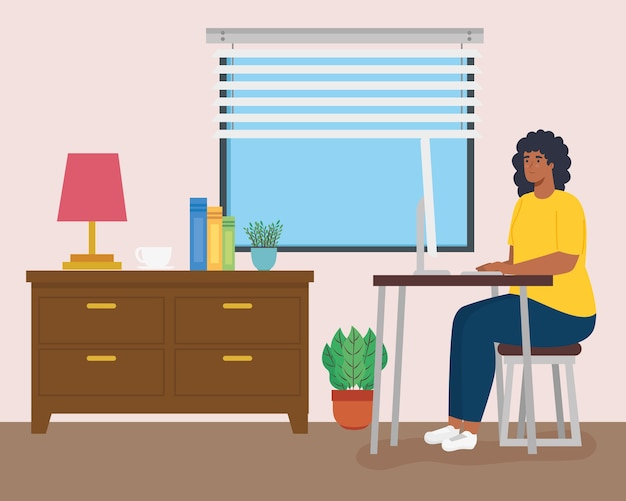 Télétravail, femme afro travaillant à domicile.