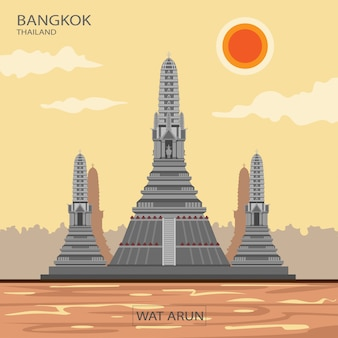 Le temple d'arun, ou temple de l'aube, est un point de repère important à bangkok, en thaïlande, avec une grande pagode ornée de céramiques de nombreuses couleurs.
