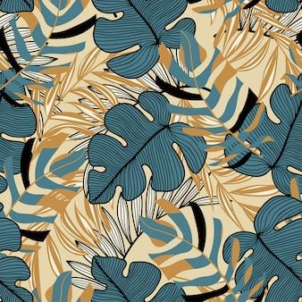 Tendance abstraite modèle sans couture avec des feuilles tropicales colorées et des plantes sur fond jaune