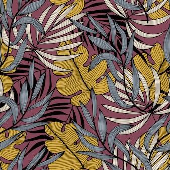 Tendance abstraite modèle sans couture avec des feuilles tropicales colorées et des plantes sur fond rose