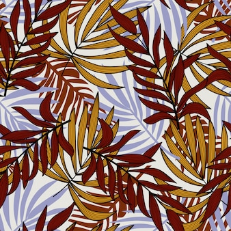 Tendance modèle sans couture avec les feuilles et les plantes tropicales.