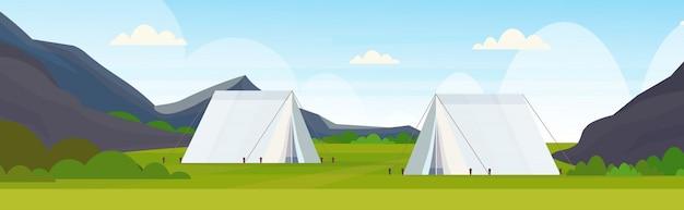 Tente aire de camping camping camp d'été voyage vacances concept montagnes paysage belle nature fond plat horizontal