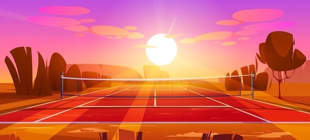 Terrain de sport de court de tennis avec filet au coucher du soleil
