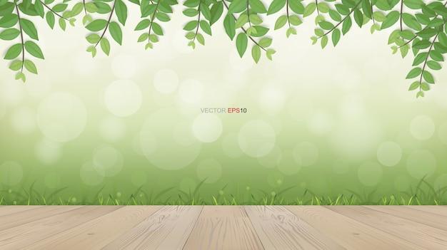 Terrasse en bois avec encadrement de feuilles vertes et espace naturel verdoyant