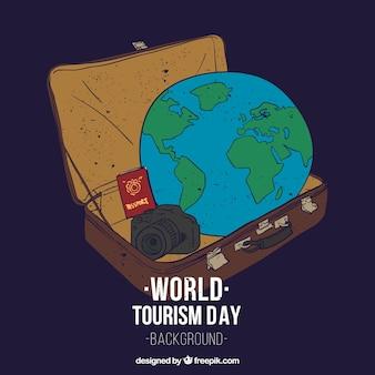 Terre dans une valise avec passeport et caméra