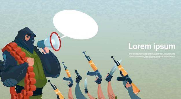 Terrorisme armé groupe terroriste masque noir tenir arme mitrailleuse chef commandement