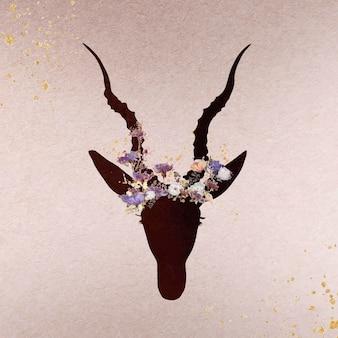 Tête d'antilope décorée de silhouette de fleurs