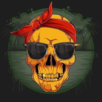 Tête de crâne humain doré avec bandana rouge et lunettes de soleil