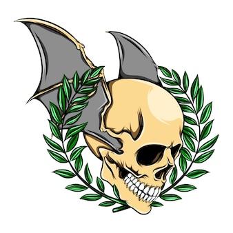 La tête de crâne de mort avec les ailes et les feuilles de chauve-souris