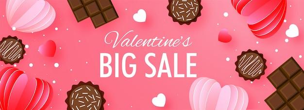 En-tête de grande vente ou conception de bannière avec des coeurs coupés en chocolat et en papier