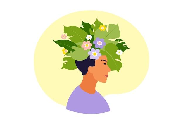 Tête d'homme heureux avec des fleurs à l'intérieur.