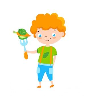 Tête de lecture petit garçon avec des aliments biologiques crus sur la fourche.