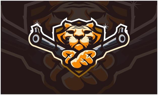 Tête de tigre tenant deux armes à feu,