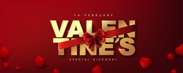 Texte doré de la saint-valentin calligraphique et luxe rouge ruban réaliste.