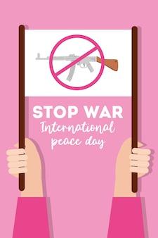 Texte de la journée internationale de la paix avec les mains soulevant une pancarte d'arrêt de la guerre