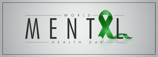 Texte de la journée mondiale de la santé mentale avec croix de ruban vert sur fond gris. conception d'en-tête ou de bannière.