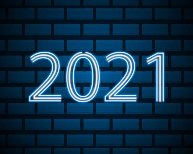 Texte néon 2021 sur mur de briques