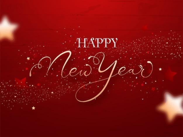 Texte d'or et d'argent bonne année avec des confettis sur fond de texture en bois rouge