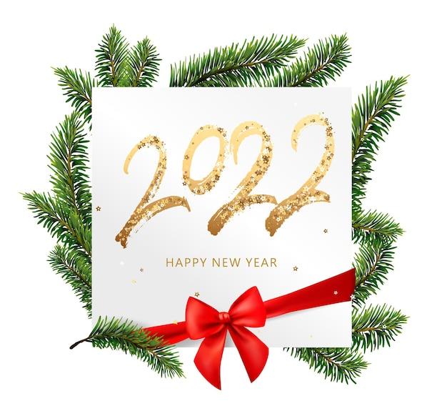 Texte d'or de bonne année avec des étincelles lumineuses sur la carte blanche
