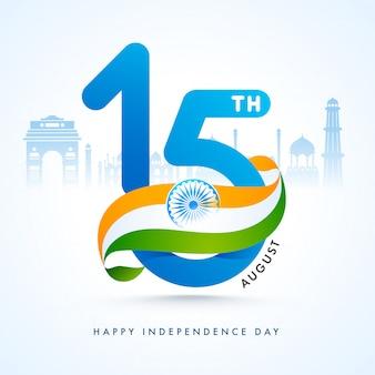 Texte avec ruban de drapeau indien et monuments célèbres de l'inde pour le joyeux jour de l'indépendance.