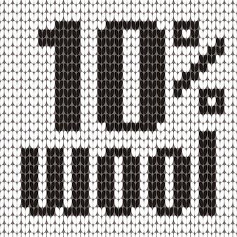 Texte tricoté. 10 pour cent de laine. en couleurs noir et blanc.