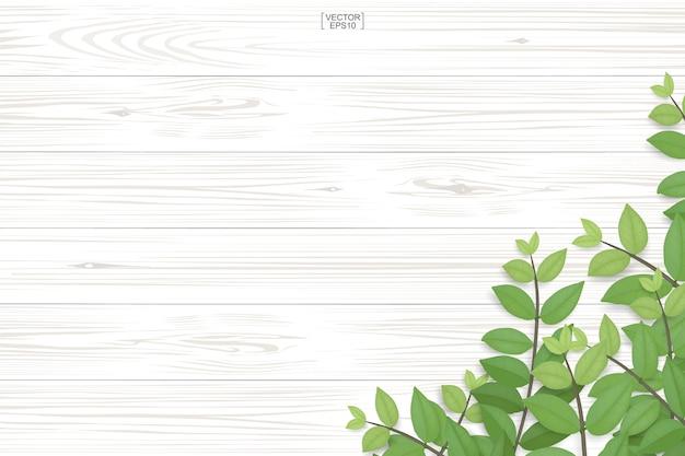 Texture bois avec des feuilles vertes.