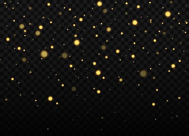 Texture de confettis et de paillettes dorées sur transparent noir