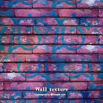 Texture du mur de briques avec des graffitis
