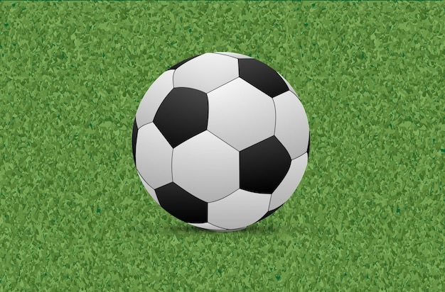 Texture d'herbe verte avec ballon de foot