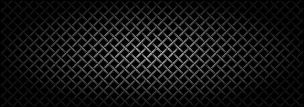 Texture de microphone de grille métallique sur fond sombre.