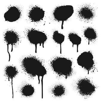 Texture peinte par pulvérisation. ensemble de points d'éclaboussures de peinture, de gouttes de graffiti et de peintures pulvérisées