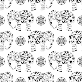 Texture sans fin avec éléphant à motifs stylisés et mandala de style indien.