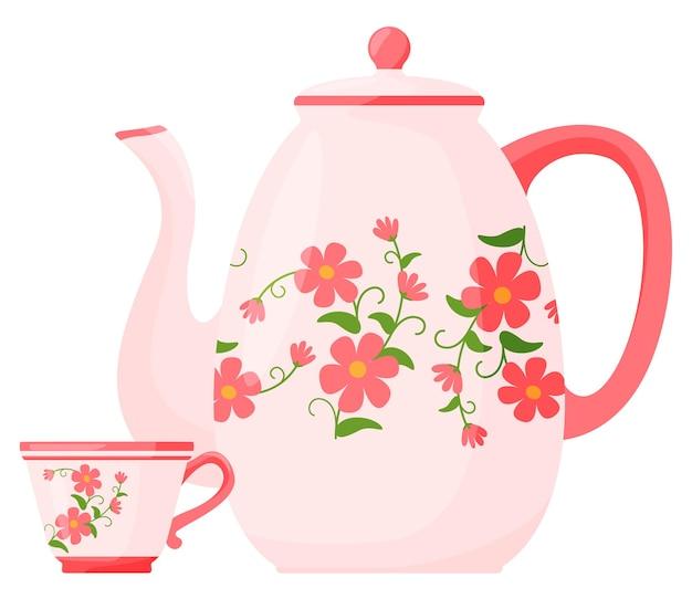 Théière avec une tasse dans un motif de fleurs.