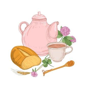 Théière, tasse de thé, miche de pain, louche de miel, fleurs de trèfle et oreille de céréales.