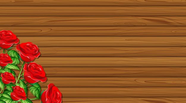 Thème de la saint-valentin avec planche de bois et roses rouges