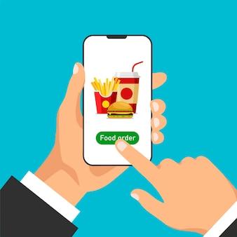 Tient le smartphone et commande de la nourriture en ligne