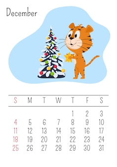 Tiger habille un arbre de noël. page de calendrier vertical pour décembre 2022 avec un personnage de dessin animé