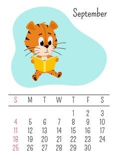 Tiger lit un livre. modèle de page de calendrier mural vertical pour septembre 2022. la semaine commence le dimanche