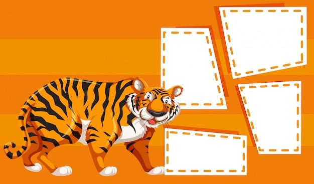 Un tigre sur des cadres de notes vierges