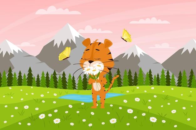 Le tigre de dessin animé mignon renifle des fleurs sur le fond des montagnes et des champs. paysage de printemps.