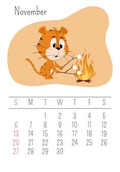 Le tigre fait griller des guimauves en feu. page de calendrier vertical pour novembre 2022 avec un personnage de dessin animé