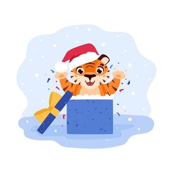 Un tigre joyeux saute d'une boîte-cadeau autour de confettis animal de dessin animé du nouvel an chinois 2022