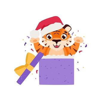 Un tigre joyeux saute d'un coffret cadeau autour de confettis le symbole du nouvel an chinois 2022