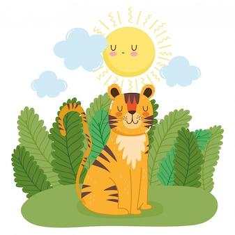 Tigre mignon assis sur la forêt verte