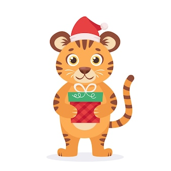 Tigre mignon dans un chapeau de père noël avec le cadeau de noël année du tigre
