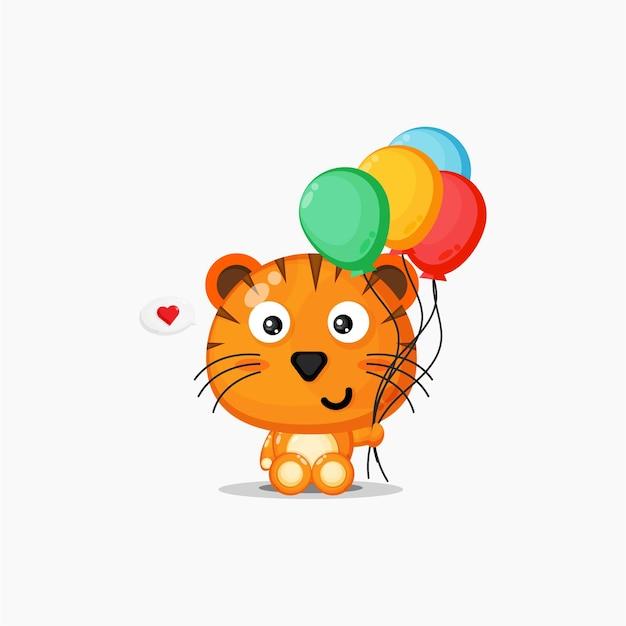 Tigre mignon portant des ballons